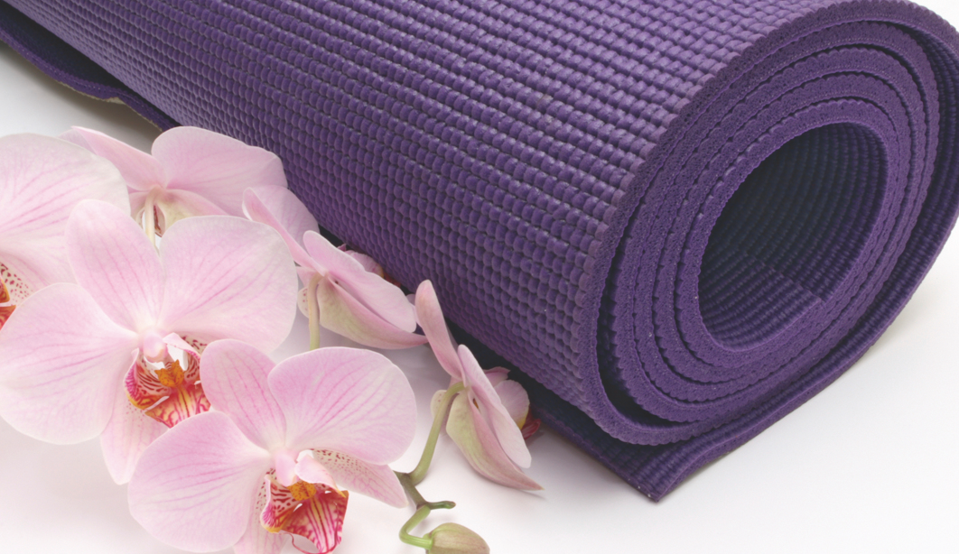 Purple yoga mat with orchids